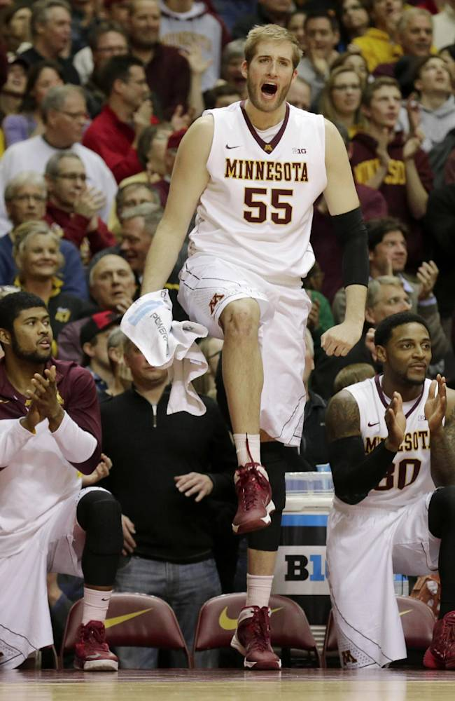 Minnesota center Elliott Eliason (55) and teammates cheer from the bench during the second half of an NCAA college basketball game in Minneapolis, Tuesday, Feb. 25, 2014. Minnesota won 95-89