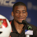 Louisville's Devante Parker answers a question during a news conference at the Atlantic Coast Conference Football kickoff in Greensboro, N.C., in this July 20, 2014 file photo. Parker broke his foot at practice late last week and is expected to miss at l