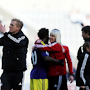 Swansea City's manager Garry Monk, left, celebrates his victory over Newcastle United at the end of their English Premier League soccer match at St James' Park, Newcastle, England, Saturday, April 19, 2014