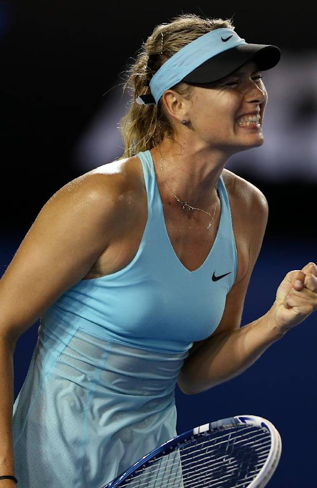 Maria Sharapova of Russia celebrates a point win against Bethanie Mattek-Sands of the U.S.  during their first round match at the Australian Open tennis championship in Melbourne, Australia, Tuesday, Jan. 14, 2014