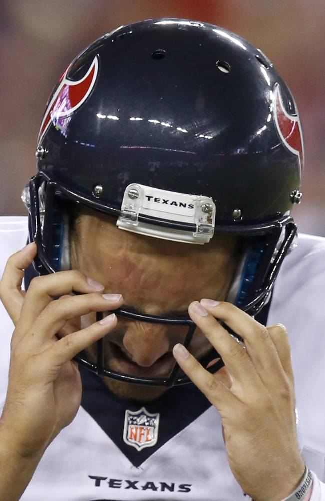 Houston Texans' Tom Savage grimaces after being sacked by the Arizona Cardinals for a safety during the second half of an NFL preseason football game Saturday, Aug. 9, 2014, in Glendale, Ariz.  The Cardinals defeated the Texans 32-0