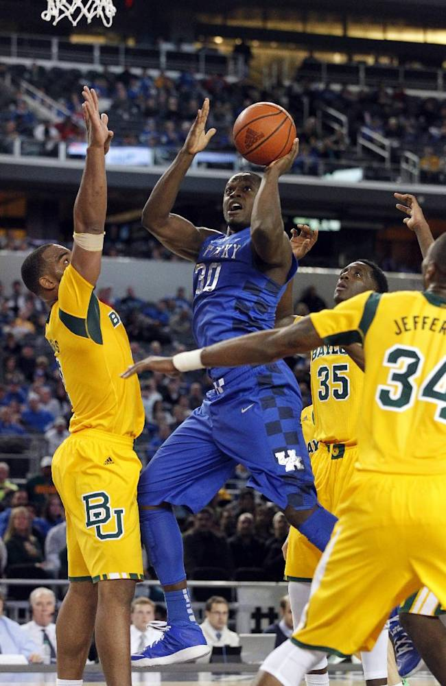 Kentucky forward Julius Randle (30) attempts a shot as Baylor's Rico Gathers, let, Cory Jefferson (34) and Taurean Prince, rear, defend in the second half of an NCAA college basketball game, Friday, Dec. 6, 2013, in Arlington, Texas. Baylor upset Kentucky 67-62