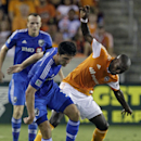 Montreal Impact Eric Miller, left, is challenged by Houston Dynamo Omar Cummings, right, during the first half of a soccer game at BBV Compass Stadium Saturday, Sept. 6, 2014, in Houston The Associated Press