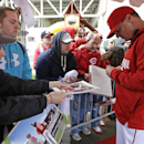 Cincinnati Reds right fielder Jay Bruce, right, signs autographs on a red carpet prior to a baseball game against the St. Louis Cardinals, Wednesday, April 2, 2014, in Cincinnati The Associated Press