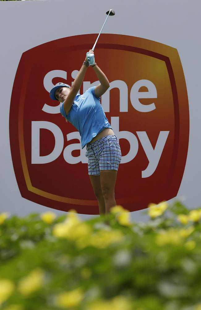 Lexi Thompson of the US hits off the 10th tee during her final round at the Malaysian LGPA event in Kuala Lumpur, Sunday, Oct. 13, 2013