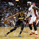 Indiana Pacers' Paul George (24) drives to the basket as Miami Heat's LeBron James (6) defends during the first half of an NBA basketball game, Friday, April 11, 2014, in Miami The Associated Press