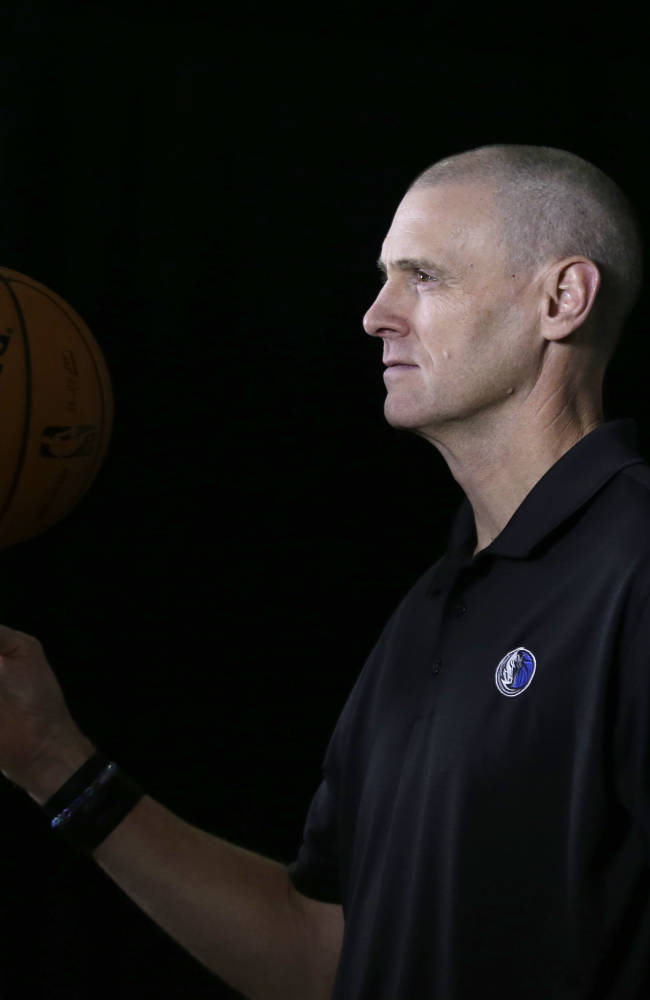 Dallas Mavericks head coach Rick Carlisle poses for a photo during the basketball team's media day Monday, Sept. 30, 2013, in Dallas