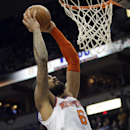 New York Knicks' Tyson Chandler goes up for a dunk in the second half of an NBA basketball game against the Minnesota Timberwolves, Wednesday, March 5, 2014, in Minneapolis. The Knicks won 118-106 The Associated Press