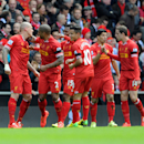 Liverpool's Martin Skrtel left, celebrates with his team-mates after he scores the second goal of the game for his side during their English Premier League soccer match against Manchester City at Anfield in Liverpool, England, Sunday April. 13, 2014. (AP