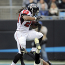 Falcons climb to 1st place despite losing record The Associated Press