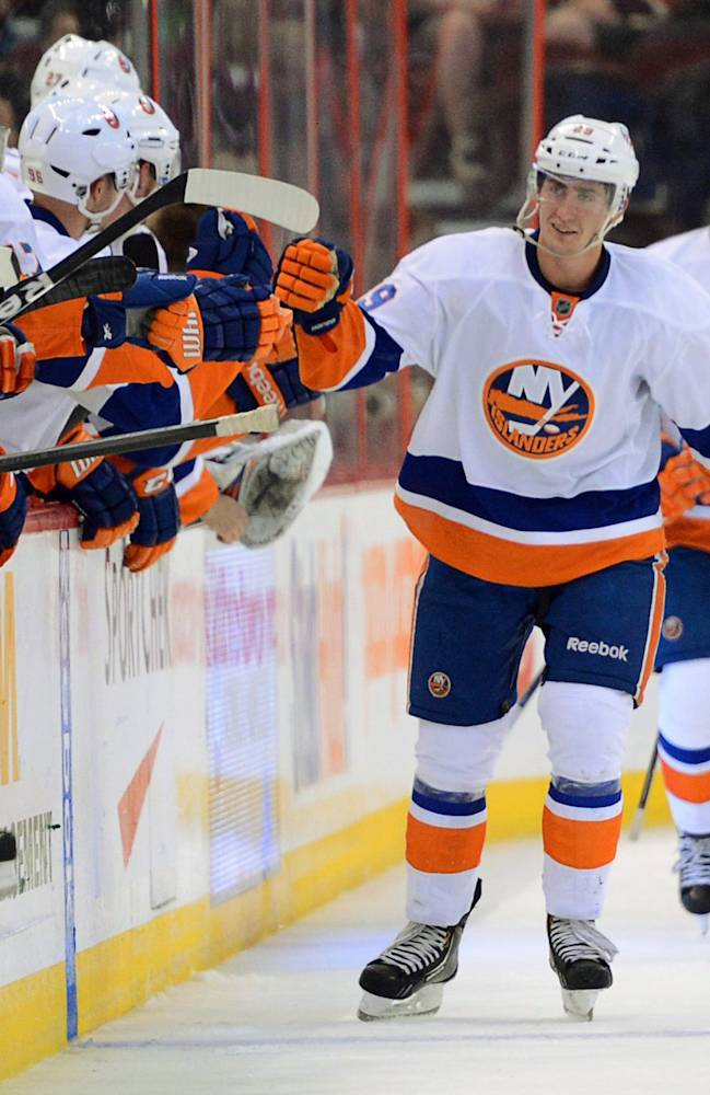 New York Islanders' Brock Nelson skates past the bench for hi-fives after scoring a second period goal against the Ottawa Senators during pre-season NHL hockey action in Ottawa, Ontario, on Sunday, Sept. 29, 2013