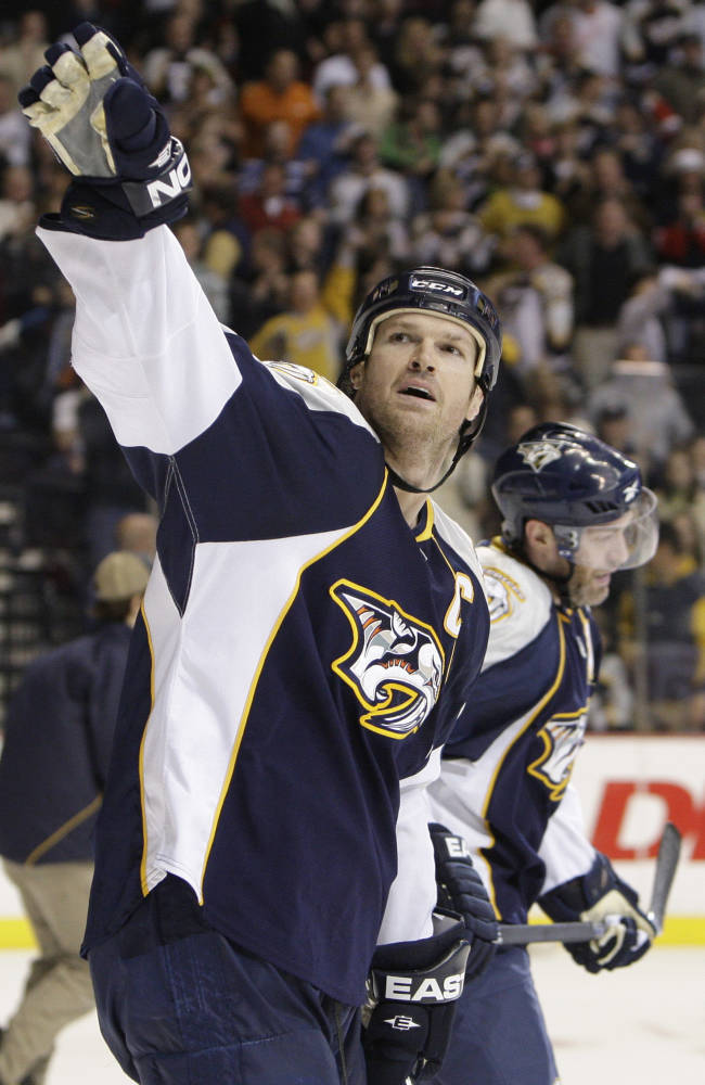 In this Feb. 28, 2009, file photo, Nashville Predators center Jason Arnott waves to the stands after scoring his third goal of  the game for a hat trick against the Detroit Red Wings in an NHL hockey game in Nashville, Tenn.  Arnott has announced his retirement after playing 1,244 games in 18 NHL seasons. Arnott was the No. 7 overall pick by the Oilers in 1993 and recorded the first 239 points of his career with Edmonton. He finished with 938 points (417 goals and 521 assists), playing for the New Jersey Devils, Dallas Stars, Nashville Predators, Washington Capitals and St. Louis Blues. Arnott had not played since the end of the 2011-12 season. He won the only Stanley Cup of his career with the Devils in 2000