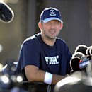 Cowboys' Romo happy to spend hours nursing back The Associated Press
