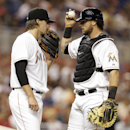 Miami Marlins starting pitcher Tom Koehler, left, talks with catcher Jarrod Saltalamacchia during the first inning of the MLB National League baseball game against the Washington Nationals, Tuesday, April 15, 2014, in Miami The Associated Press