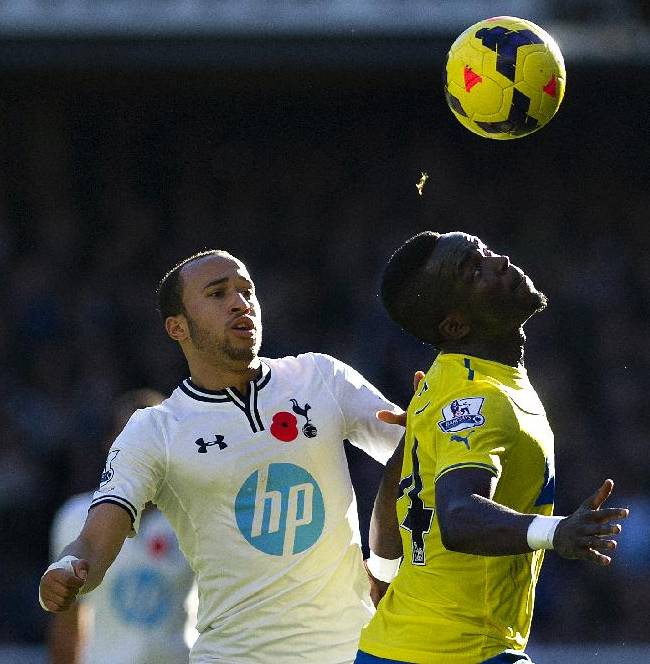 Tottenham Hotspur's Andros Townsend, left, fights for the ball with Newcastle United's Cheik Ismael Tiote during their English Premier League soccer match at the White Hart Lane stadium in London, Sunday Nov. 10, 2013
