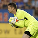 Aston Villa goalie Shay Given stops a shot from Andres Escobar in the first half of an international friendly soccer match, Wednesday, July 23, 2014, in Frisco, Texas. Aston Villa won 2-0