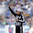 In this Dec. 30, 2012, file photo, Referee Bill Vinovich makes a call in the second quarter of an NFL football game between the Tennessee Titans and the Jacksonville Jaguars in Nashville, Tenn. One momen Vinovich was lifting weights to stay in shape for t