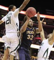 Toledo's Reese Holliday, center, shoots between Ohio's Jon Smith, left, and Walter Offutt in the first half during an NCAA college basketball game in the Mid-American Conference men's quarterfinals Thursday, March 8, 2012, in Cleveland. (AP Photo/Tony Dejak)