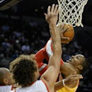 Houston Rockets' Dwight Howard, right, shoots against Portland Trail Blazers' Robin Lopez (42) and Nicolas Batum (88) during the first half of an NBA basketball game in Portland, Ore., Thursday Dec. 12, 2013 The Associated Press