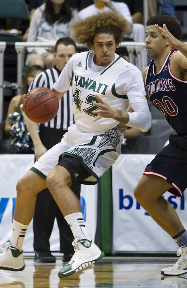 Hawaii forward Isaac Fotu (42) posts up against St. Mary's forward Brad Waldow (00) in the first half of an NCAA college basketball game at the Diamond Head Classic Monday, Dec. 23, 2013, in Honolulu