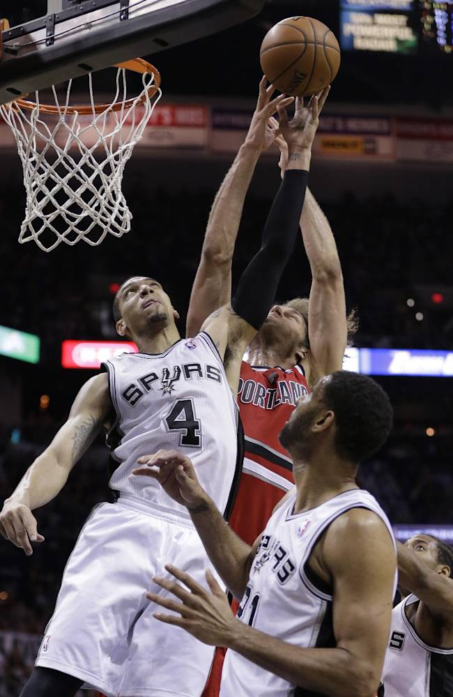 San Antonio Spurs' Danny Green (4) and Portland Trail Blazers' Robin Lopez (42) battle for a rebound as Tim Duncan (21) looks on during the second half of Game 5 of a Western Conference semifinal NBA basketball playoff series, Wednesday, May 14, 2014, in San Antonio. San Antonio won 104-82
