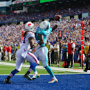 Miami Dolphins wide receiver Mike Wallace (11) makes a touchdown catch in front of Buffalo Bills cornerback Stephon Gilmore (24) during the second half of an NFL football game on Sunday, Sept. 14, 2014, in Orchard Park, N.Y The Associated Press