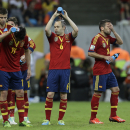Spain's Gerard Pique, Pedro Rodriguez, Andres Iniesta and Jordi Alba, from left, cool themselves during the soccer Confederations Cup group B match between Spain and Uruguay at the Arena Pernambuco in Recife, Brazil, Sunday, June 16, 2013. (AP Photo/Natacha Pisarenko)