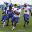 New York Giants' Victor Cruz, second from right, runs into the end zone during practice at a NFL football camp in East Rutherford, N.J., Thursday, July 24, 2014 The Associated Press