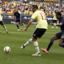 IMAGE DISTRIBUTED FOR GUINNESS INTERNATIONAL CHAMPIONS CUP - AC Milan's Adil Rami (13) sends a ball past Manchester City's Scott Sinclair (12) during Guinness International Champions Cup game against Manchester City vs. AC Milan, on Sunday, July 27, 2014