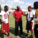 Washington Redskins receiver Pierre Garcon, left, is interviewed by NFL Network's Deion Sanders, along with receiver DeSean Jackson, second from right, and quarterback Robert Griffin III, right, after practice at the team's NFL football training facility,