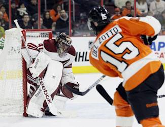 Philadelphia Flyers' Michael Del Zotto (15), right, shoots and scores past Arizona Coyotes goalie Mike Smith (41) in the second period of an NHL hockey game, Tuesday, Jan. 27, 2015, in Philadelphia. (AP Photo/Tom Mihalek)