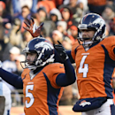 Denver Broncos kicker Matt Prater, left, celebrates a 64-yard field goal with Britton Colquitt during the first half of an NFL football game against the Tennessee Titans during the first half of an NFL football game on Sunday, Dec. 8, 2013, in Denver. (AP Photo/Jack Dempsey)