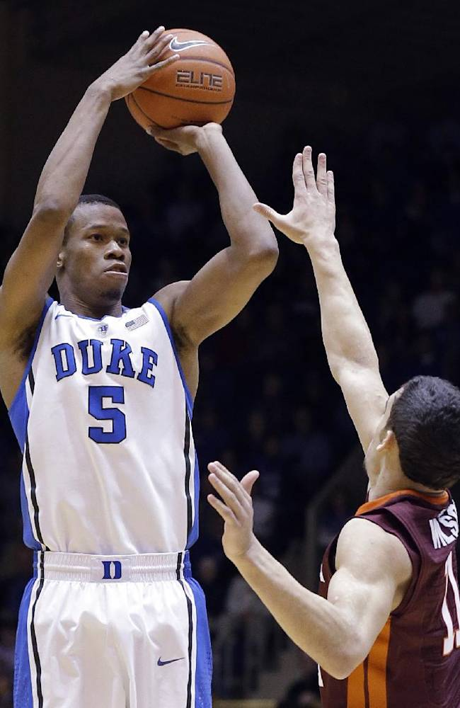 In this Feb. 25, 2014 file photo, Duke's Rodney Hood (5) shoots over Virginia Tech's Devin Wilson during the first half of an NCAA college basketball game in Durham, N.C. Hood is entering the NBA draft. Hood said in a statement Friday, April 18, 2014, that playing for Mike Krzyzewski