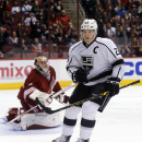 Los Angeles Kings right wing Dustin Brown (23) celebrates after scoring a first-period goal against Arizona Coyotes goalie Mike Smith, left, during an NHL hockey game, Thursday, Dec. 4, 2014, in Glendale, Ariz The Associated Press