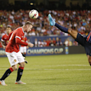 Manchester United's Wayne Rooney, left, headers the ball in front of Paris Saint-Germain's Marquinhos during a soccer match at Solider Field as Manchester United played Paris Saint-Germain during International Champions Cup play in Chicago Wednes