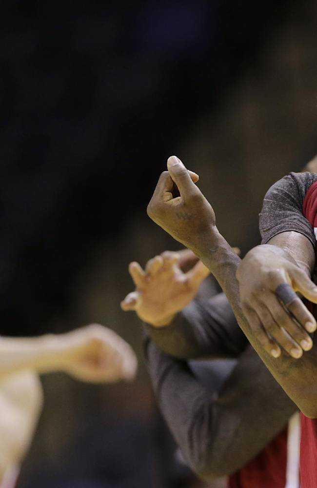 Miami Heat forward LeBron James warms up during basketball practice on Wednesday, June 4, 2014 in San Antonio. They play Game 1 of the NBA Finals against the San Antonio Spurs on Thursday