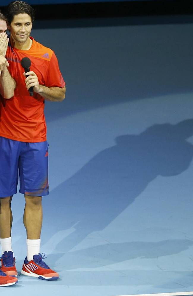 David Marrero of Spain, left holds his hands to his face as playing partner Fernando Verdasco of Spain hugs him as they speak to the crowd during the presentation ceremony after winning the final of the ATP World Tour Finals doubles, defeating Bob Bryan of United States and Mike Bryan of United States at the O2 Arena in London, Monday, Nov. 11, 2013