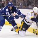 Toronto Maple Leafs' Jerred Smithson, left, pushes Nashville Predators' Matt Hendricks into the boards during the first period of an NHL hockey game, Thursday, Nov. 21, 2013 in Toronto The Associated Press