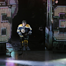 Boston Bruins left wing Brad Marchand (63) is introduced prior to the Bruins' home opener in an NHL hockey game against the Philadelphia Flyers in Boston, Wednesday, Oct. 8, 2014 The Associated Press