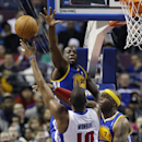 Golden State Warriors forward Draymond Green (23) and Jermaine O'Neal (7) reach in to block Detroit Pistons forward Greg Monroe's shot during the second half of an NBA basketball game in Auburn Hills, Mich., Monday, Feb. 24, 2014 The Associated Press
