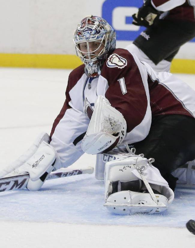Colorado Avalanche goalie Semyon Varlamov blocks a shot against the Anaheim Ducks during the second period of an NHL preseason hockey game in Anaheim, Calif., Sunday, Sept. 22, 2013