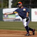 Houston Astros second baseman Jose Altuve throws to first base for the out on Atlanta Braves' Jordan Schafer in the third inning of a spring exhibition baseball game on Sunday, March 2, 2014, in Kissimmee, Fla The Associated Press