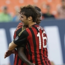 AC Milan midfielder Andrea Poli (16) congratulates AC Milan forward Mario Balotelli after he scored a goal against the Los Angeles Galaxy during the first half of the International Champions Cup third-place soccer game, Wednesday, Aug. 7, 2013, in Miami Gardens, Fla. (AP Photo/ Wilfredo Lee)