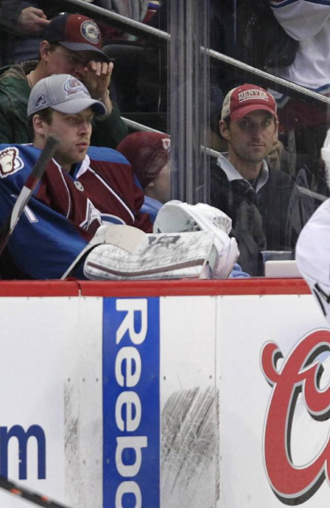 Colorado Avalanche goalie Semyon Varlamov (1) watches Los Angeles Kings right wing Justin Williams (14) during an NHL hockey game Wednesday, Feb. 26, 2014, in Denver. When Varlamov was yanked in Russia's final hockey game at the Sochi Olympics after allowing three goals in 15 shots, the shock wave was felt 6,269 miles away in Denver. But upon his return he quickly showed he was in the right frame of mind to put that disappointment behind him and focus on getting the Avalanche into the playoffs