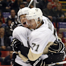Red Wings rally late to top Penguins 4-3 in OT The Associated Press