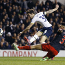 FILE - In this March 4, 2015 file photo Tottenham's Ryan Mason, top, scores a goal past Swansea's Neil Taylor during the English Premier League soccer match between Tottenham Hotspur and Swansea City at White Hart Lane stadium in London. (AP Photo/Kirsty