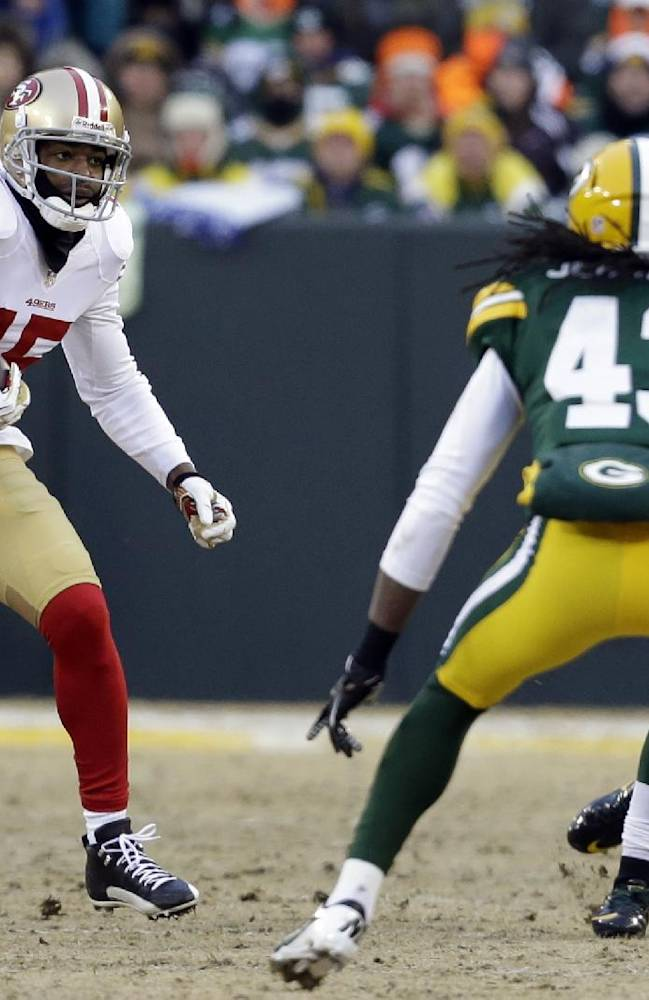 San Francisco 49ers wide receiver Michael Crabtree (15) runs against Green Bay Packers defense during the first half of an NFL wild-card playoff football game, Sunday, Jan. 5, 2014, in Green Bay, Wis