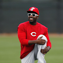 Cincinnati Reds second baseman Brandon Phillips stretches during spring training baseball practice in Goodyear, Ariz., Tuesday, Feb. 25, 2014 The Associated Press