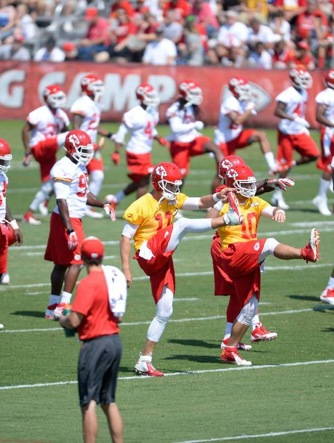 Kansas City Chiefs stretch during a NFL training camp practice on the Missouri Western State University campus, Thursday, July 24, 2014 in St. Joseph, Mo