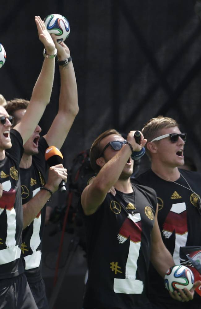 German players celebrate during a fan party after the arrival of the German national soccer team in Berlin Tuesday, July 15, 2014. Germany beat Argentina 1-0 on Sunday to win its fourth World Cup title